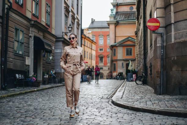 Modern woman exploring rainy Stockholm stock photo