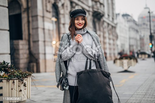 518885222istockphoto Modern woman holding large bag 1135803587