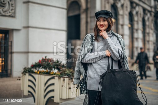 518885222istockphoto Modern woman is holding large bag 1134102430