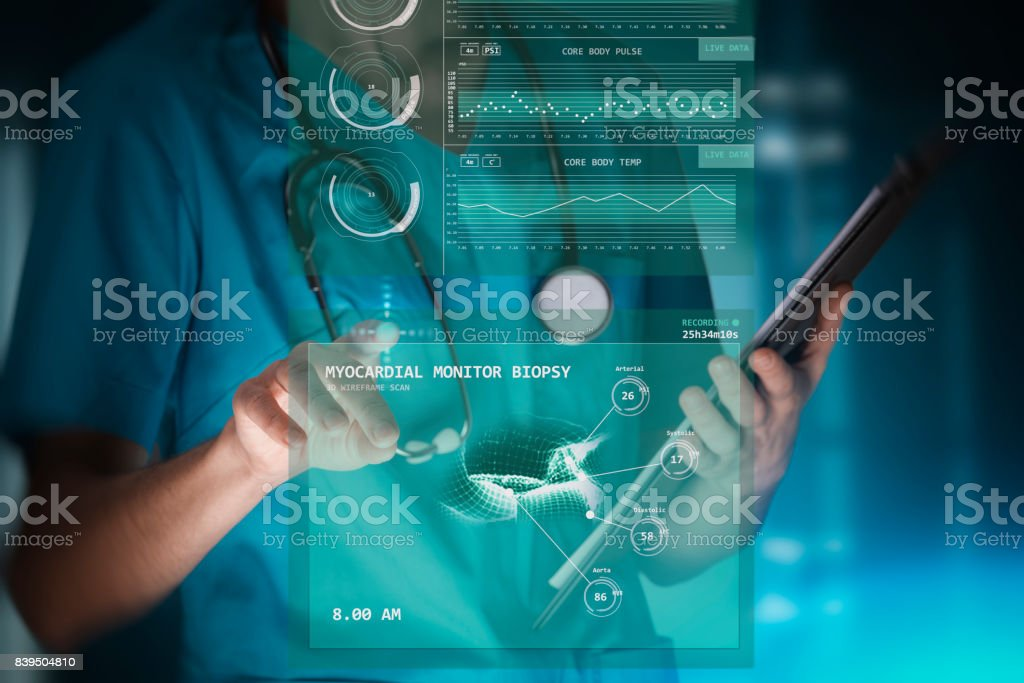 modern woman nurse or doctor is using innovative technologies, touching a holographic panel for monitoring patient general health data and recording a live myocardial biopsy scan stock photo