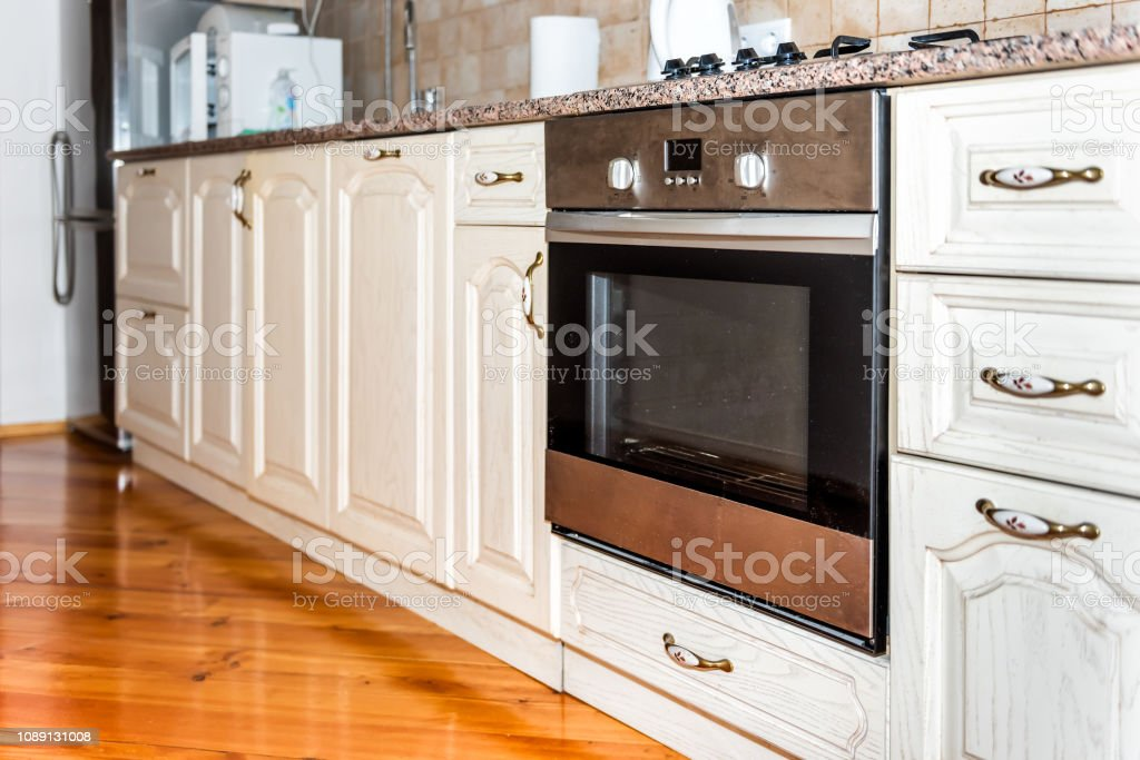 Image of: Modern Wooden Brown Kitchen Features Cabinets With Granite Countertops And Tile Backsplash With Closeup Of Dirty Oven Stock Photo Download Image Now Istock