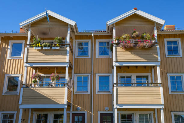 Modern wooden house (block) with balconies and flowers stock photo