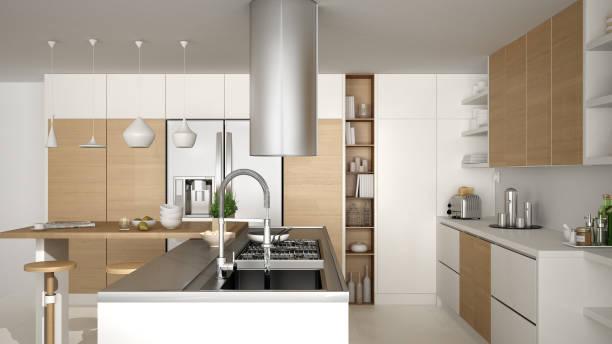 moderne holzküche mit holzelementen, nahaufnahme, gasherd mit kochen pfanne, weiße minimalistischen innenarchitektur - kochinsel stock-fotos und bilder