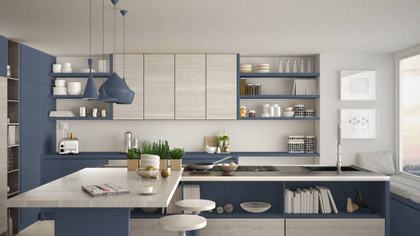Modern wooden kitchen with wooden details, close up, island and gas stove with cooking pan, white and blue minimalistic interior design stock photo