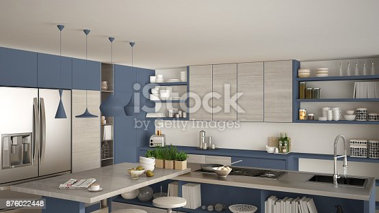 istock Modern wooden kitchen with wooden details, close up, island and gas stove with cooking pan, white and blue minimalistic interior design 876022448