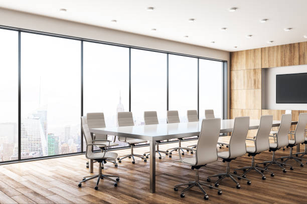 Modern wooden meeting room with poster Modern wooden meeting room interior with empty poster and panoramic city view with sunlight. Mock up, 3D Rendering board room stock pictures, royalty-free photos & images