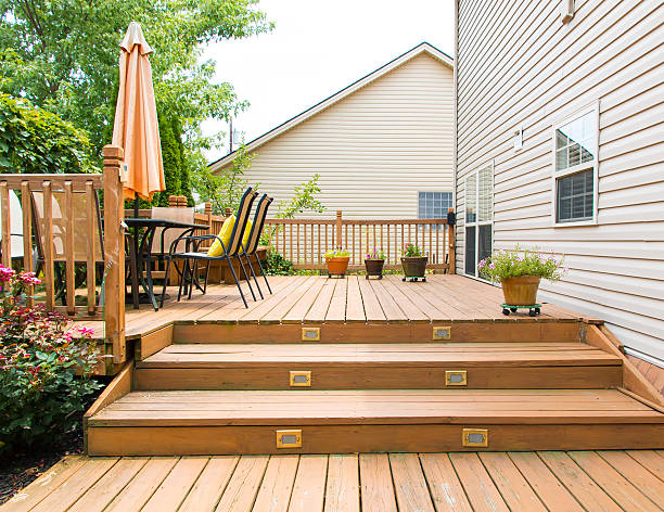 Modern wooden patio and garden area of a family house stock photo