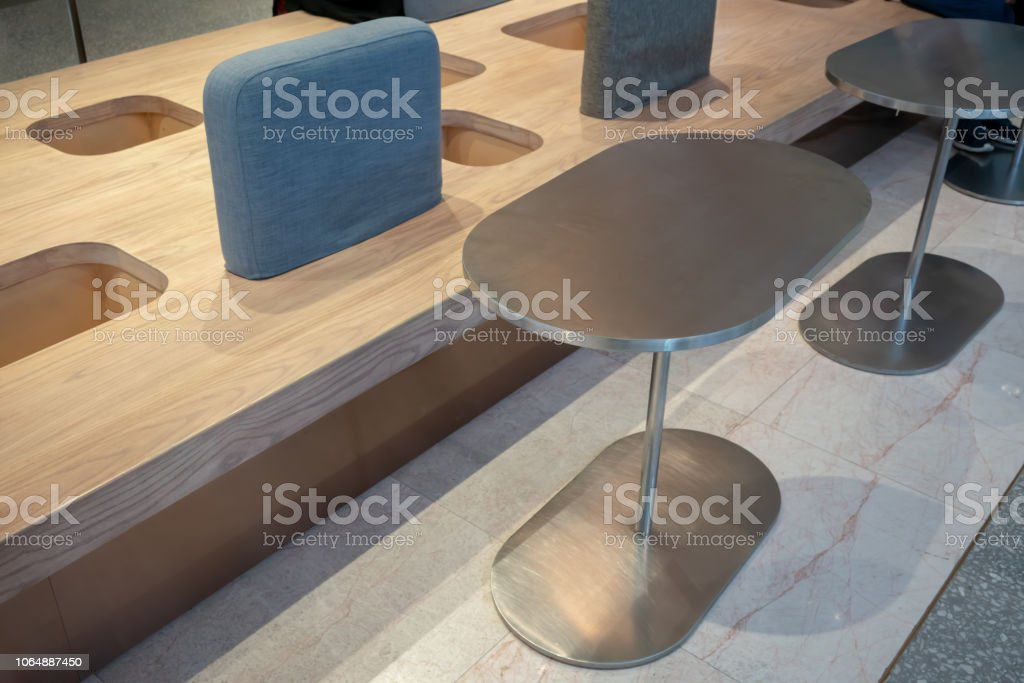 Picture of: Modern Wooden Seat With Blue Cushion And Storage Along Steel Tables For Indoor Interior Stock Photo Download Image Now Istock