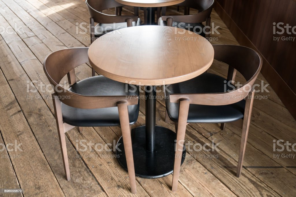 Picture of: Modern Wooden Table And Chair In Coffee Shop Stock Photo Download Image Now Istock