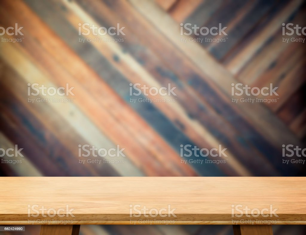 modern wooden table top at blurred diagonal wood plank wall,Template mock up for display or montage of product royalty-free stock photo