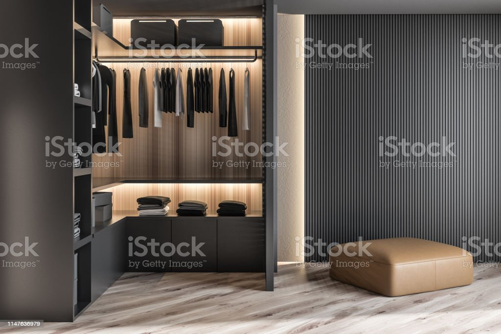 Modern Wooden Wardrobe With Clothes Hanging On Rail In ...
