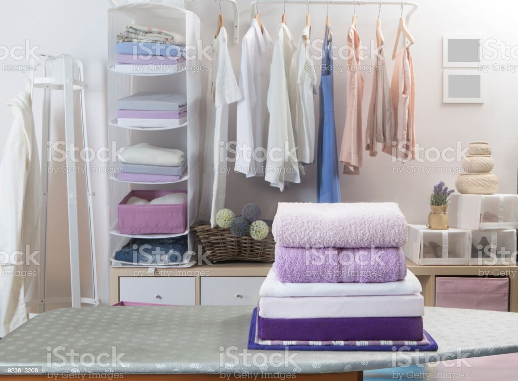 Modern wooden wardrobe with clothes stock photo