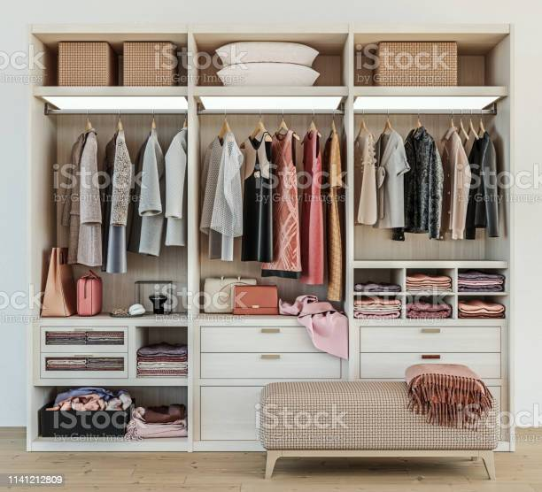 Modern wooden wardrobe with women clothes hanging on rail in walk in picture id1141212809?b=1&k=6&m=1141212809&s=612x612&h=jbxgush9xjv4pzszx9btgjk gf7vl5sgjzjyytfp7e8=