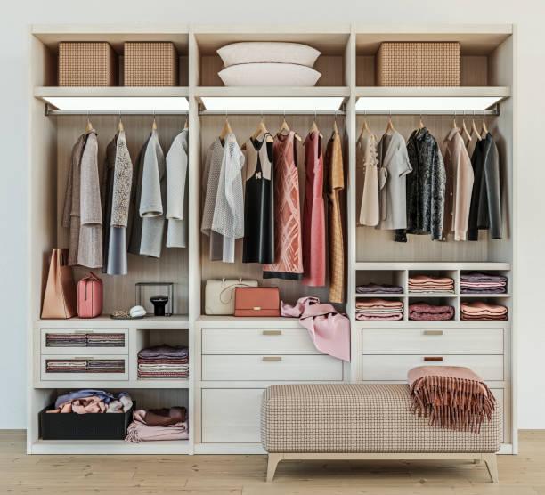 modern wooden wardrobe with women clothes hanging on rail in walk in closet design interior, 3d rendering - порядок стоковые фото и изображения