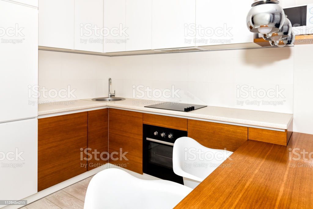 Modern Wooden White Orange Kitchen Features Cabinets In Small Apartment Studio Bar Stool Counter Interior Design And Nobody In Minimalist Home Stock Photo Download Image Now Istock