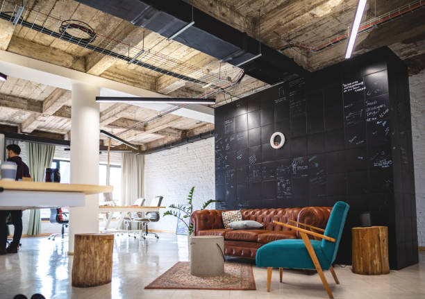 Modern work space Modern but retro styled office. coworking stock pictures, royalty-free photos & images