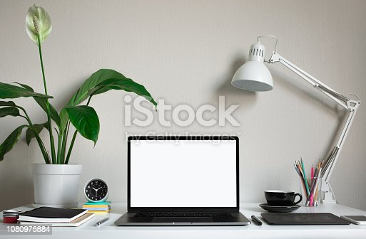 istock Modern work table with blank computer laptop and accessories in home office studio.Freelance designer or blogger concepts ideas 1080975884
