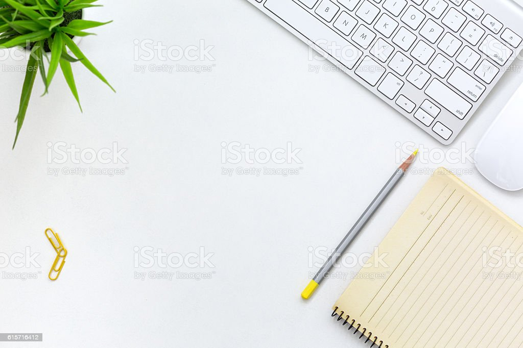 Modern working Place on White Office Desk with yellow