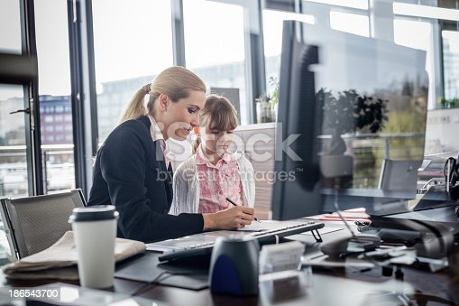istock Modern working woman with child 186543700