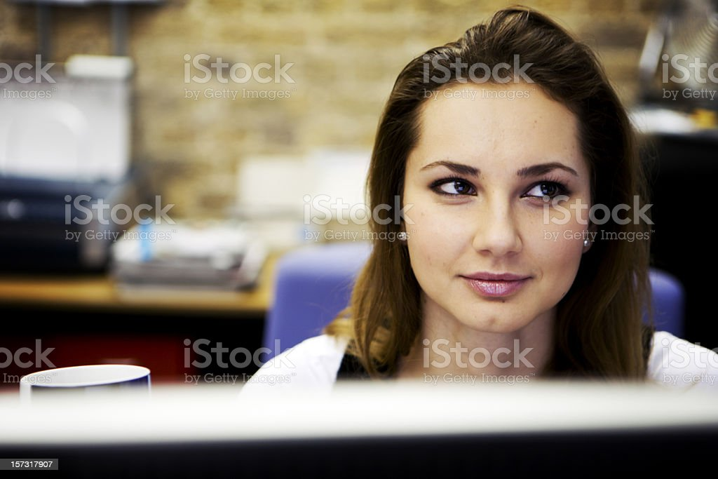 modern workplace: a contemporary creative professional at her desk royalty-free stock photo