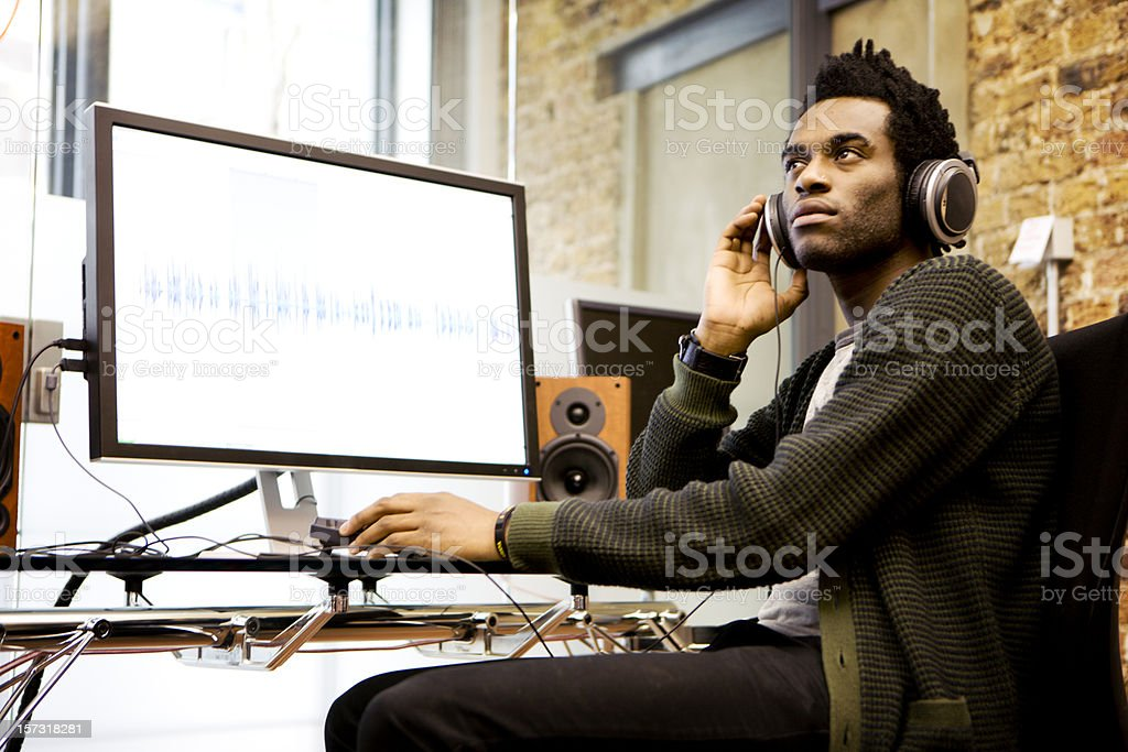 modern workplace: audio engineer in his sound production studio stock photo