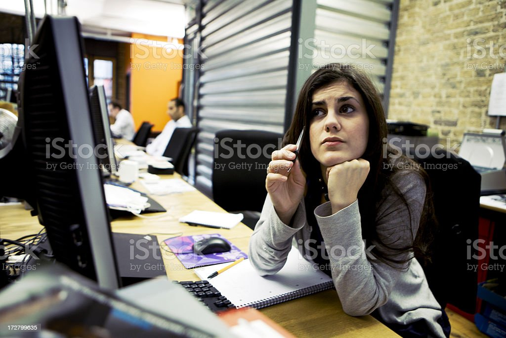 modern workplace: candid creative concern royalty-free stock photo