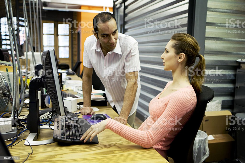 modern workplace: creative office colleagues in discussion royalty-free stock photo