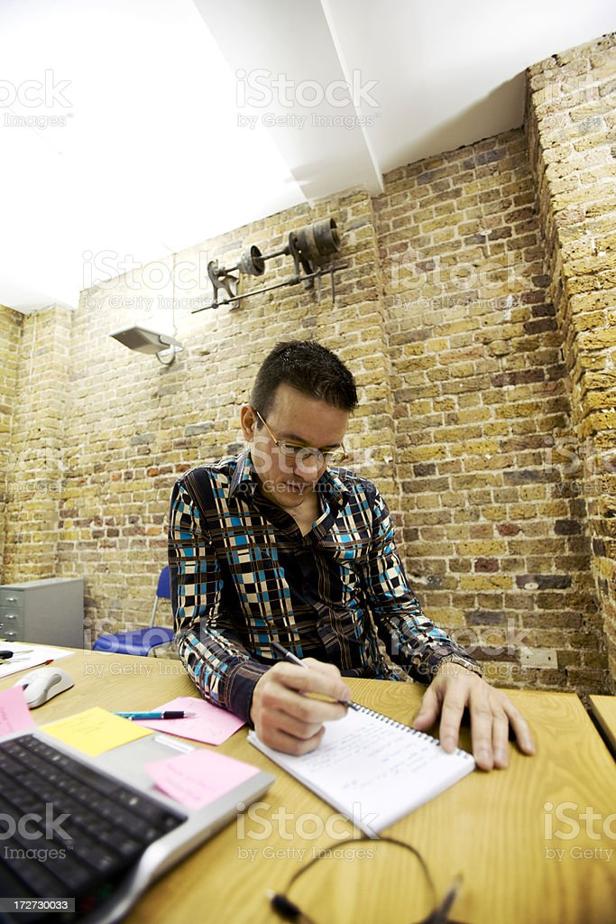 modern workplace: creative professional sketching ideas with pen and paper stock photo