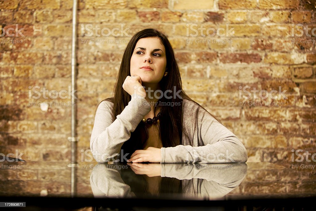 modern workplace: female professional in thoughtful contemplation royalty-free stock photo