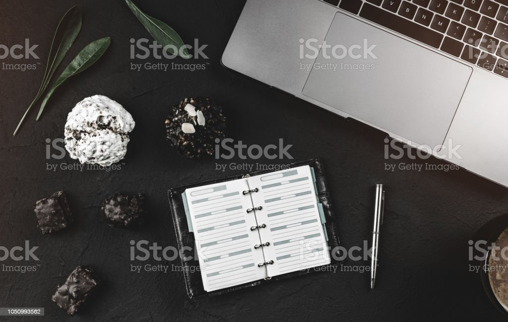 Modern Workspace For A Businessman Laptop And Work Notepad