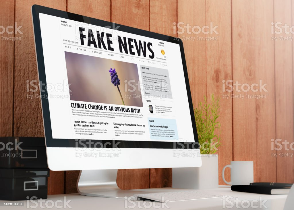 modern workspace with computer fake news stock photo