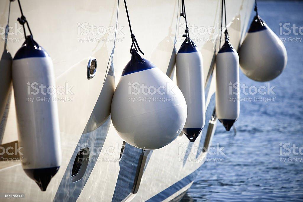 Modern yacht fenders stock photo