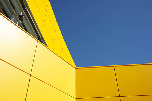 Modern Yellow Architecture Against Blue Sky stock photo