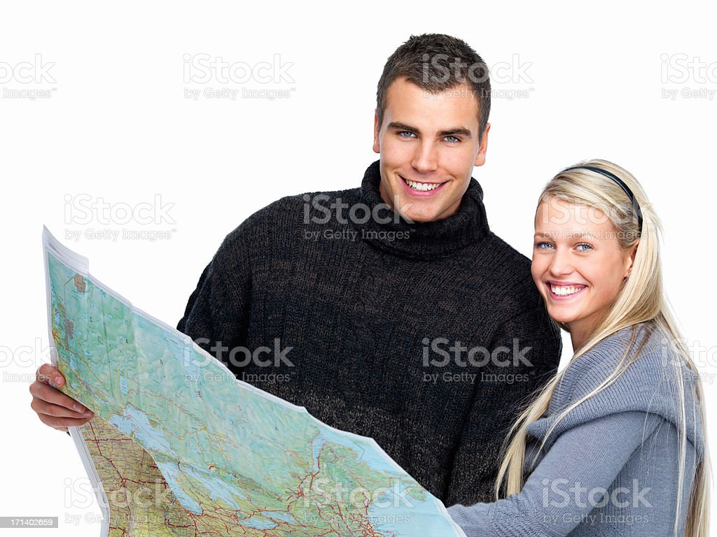 Modern young couple reading a travel map royalty-free stock photo