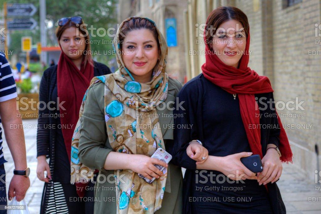 Modern young Iranian women wearing hijabs, Shiraz, Iran. stock photo
