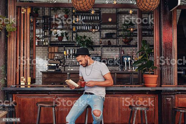 Modern young man reading a book in cafe picture id579128416?b=1&k=6&m=579128416&s=612x612&h=yqnioqonrcyxcxecg wosbp88njwrmde s3l46wy6by=