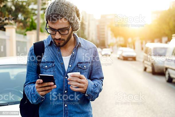 Modern Young Man With Mobile Phone In The Street Stock Photo - Download Image Now