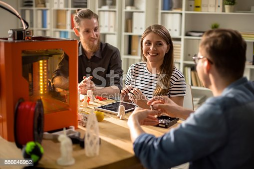886646936 istock photo Modern Young People Working on 3D Project 886646952