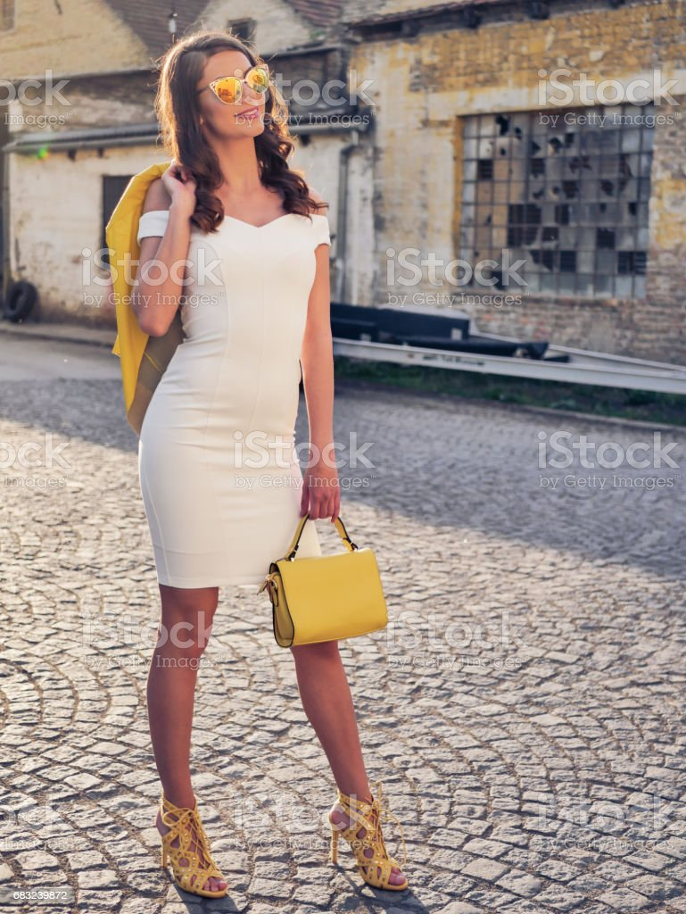 Modern young woan in dress and heels 免版稅 stock photo