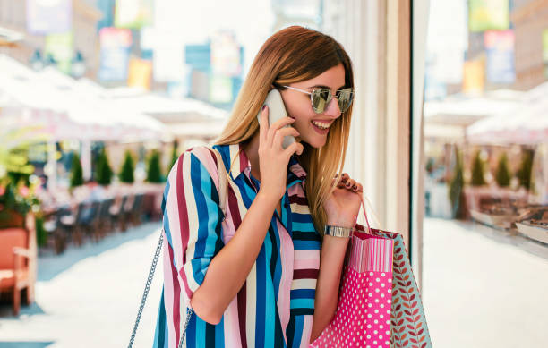 Modern young woman enjoying in shopping. Consumerism, fashion, lifestyle concept stock photo