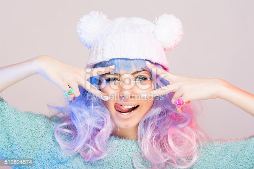 istock Modern young woman with pastel pink and blue hair 512824574