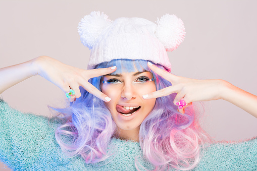 Modern young woman with pastel pink and blue hair