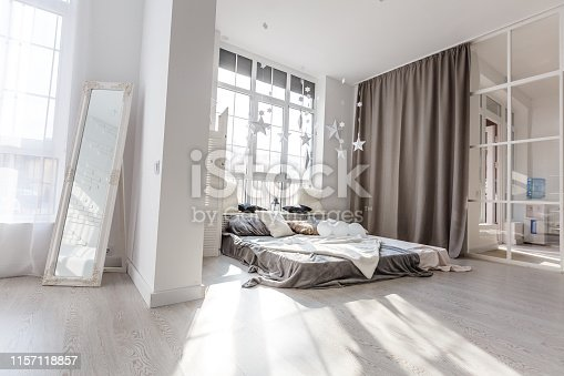 istock Modern,bright,clean,living ,study room and kitchen interior with glass partition in a loft style house , Interior photography. 1157118857