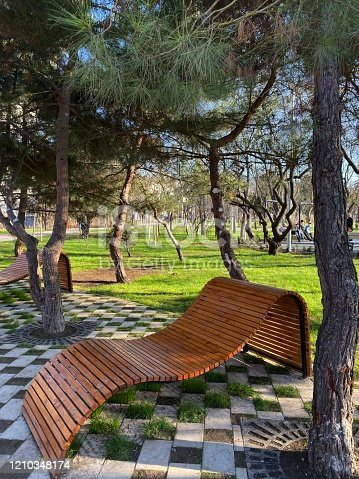 601026242 istock photo Modernist bench to rest from wooden bars in public fghrt in the city 1210348174
