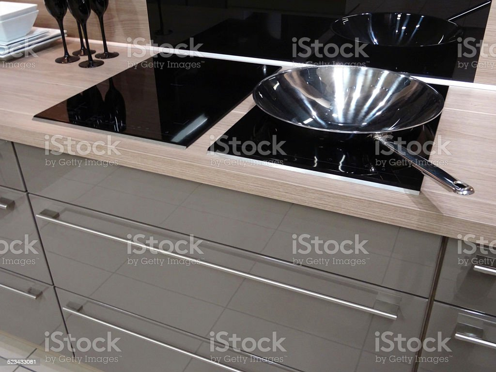Modern-kitchen, touch electric induction, built-in ceramic hob cooker, drawers, glossy-cabinets stock photo