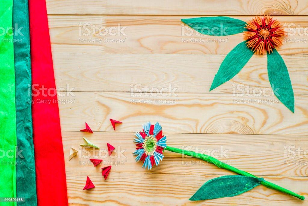Modular origami flowers on rustic wooden background with paper and modular origami flowers on rustic wooden background with paper and origami modules royalty free stock mightylinksfo