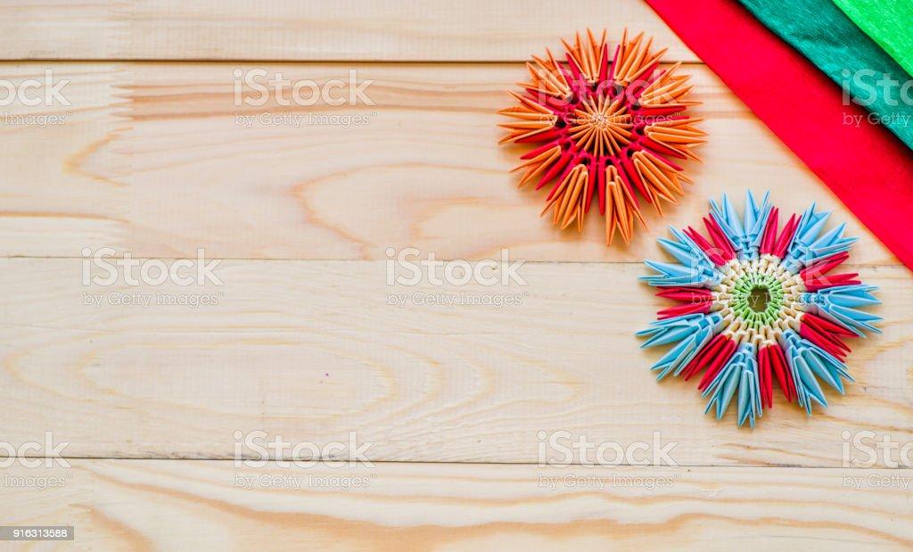 Modular origami flowers on rustic wooden background with paper stock modular origami flowers on rustic wooden background with paper royalty free stock photo mightylinksfo