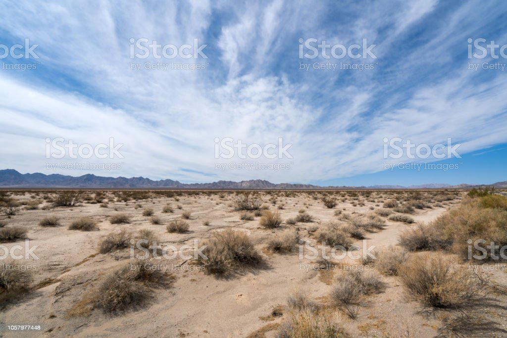 Mohave Desert landscape with blue cloudy skies (Arizona / California) stock photo