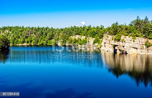 Mohonk lake, nestled in the Shawangunk Mountains and surrounded by dense forests and nature in New Paltz, New York.