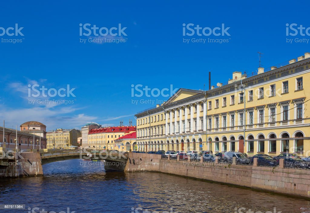 Moika river embankment with old buildings and bridge in Saint Petersburg, Russia stock photo